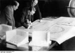 Albert Speer, Adolf Hitler, and architect Ruff reviewing the plans for the Nazi Party rallying ground to be built at Nürnberg, Germany, circa 1934-1935