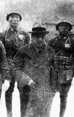 Hisao Tani being escorted by Chinese soldiers during his war crimes trial in Nanjing, China, 1947