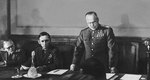 Georgy Zhukov reading the act of the German surrender, with Arthur Tedder seated next to him, Berlin, 8 May 1945