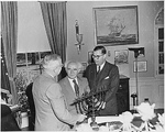 Israeli Prime Minister David Ben-Gurion presenting US President Harry Truman with a Menorah, White House, Washington DC, United States, 8 May 1951; Israeli Ambassador to US Abba Eban also present