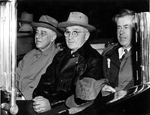 US President Franklin Roosevelt, Harry Truman, and Vice President Henry Wallace in a car, en route from Union Station to Capitol, Washington DC, United States, 10 Nov 1944