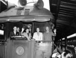 Harry Truman with his wife Bess and daughter Margaret waving from the train during the 1948 Presidential campaign, somewhere in the United States, 2 Oct 1948