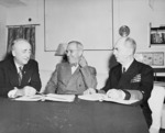 US Secretary of State James Byrnes, President Harry Truman, and Admiral William Leahy meeting aboard USS Augusta, 12 Jul 1945