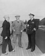 US President Harry Truman, Secretary of State James Byrnes, and Captain James Foskett aboard USS Augusta, 11 Jul 1945, photo 2 of 2