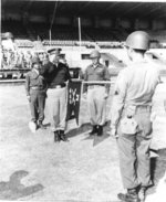 US Army Lieutenant General Lucian Truscott of 5th Army saluting the guidon of 442nd RCT, Livorno, Italy, Sep 1945