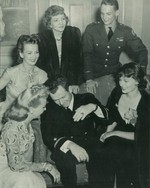George Welch with Hollywood stars Claudette Colbert, Carole Landis, Betty Grable, and Ruth Hussey, 28 Jun 1942; seen in 13 Jul 1942 issue of Life magazine