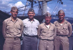 Lieutenant Howard W. Whalen (in grey uniform) with other officers of USS Sanborn, 1945