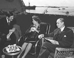 John Winant, Anna Boettiger, and Harry Hopkins aboard USS Quincy off Egypt, 14 Feb 1945