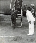 Yi Woo exiting an aircraft, 1 Jun 1943