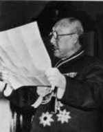 Manchukuo Prime Minister Zhang Jinghui reading a document, date unknown
