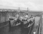 USS ABSD-1 with USS LSM-67 and USS LSM-218 in the dock, Espiritu Santo, New Hebrides, 17 Nov 1944