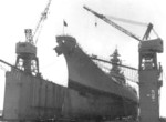 USS AFDB-1 with USS Wisconsin in the dock, Orote, Guam, Mariana Islands, circa Apr 1952
