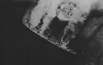 Repair ship Akashi burning as the result of US carrier aircraft attack, Palau Islands, 30 Mar 1944