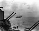 USS Alabama firing in exercise somewhere in the South Pacific, 29 Oct 1943; note secondary guns of USS South Dakota in foreground