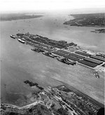 Alaska, Guam, North Carolina, Washington, Enterprise, Franklin, and other ships at  Bayonne Naval Supply Depot, New Jersey, United States, 15 Apr 1953