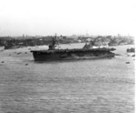 USS Anzio at anchor in the Huangpu River, Shanghai, China, 1 Dec 1945