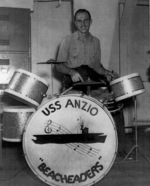 AMM 3rd Class L. H. McDowell at the drums during an orchestra performance aboard USS Anzio, 18 Feb 1945