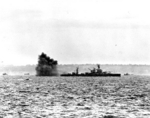 Battleship Arkansas firing her 12-in guns on German positions off Omaha Beach, Normandy, France, 6 Jun 1944