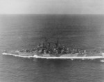 USS Astoria underway en route to Philadelphia Naval Shipyard, 22 Jul 1944; note camouflage Measure 33 Design 24d