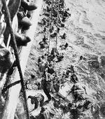 Survivors of battleship Bismarck being pulled aboard HMS Dorsetshire, 27 May 1941