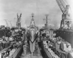 Destroyer Claxton, heavy cruiser Canberra, and destroyer Killen being repaired in floating drydock USS ABSD-2, Manus, Admiralty Islands, 2 Dec 1944