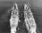 USS Boston and USS Canberra practicing high-line operations for the transfer of WW2 Unknown Soldier, 22 Apr 1958