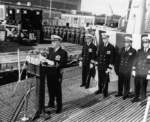 Lieutenant Eugene Dente speaking at the USS Capitaine recommissioning ceremony, Mare Island Navy Yard, Vallejo, California, United States, 23 Feb 1957