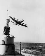 P3V aircraft flying over USS Capitaine, summer 1960