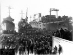 Commissioning ceremony of USS Cassin Young, San Pedro, California, United States, 31 Dec 1943; note USS Preston at left and USS Comfort at right