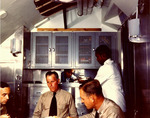 Lieutenant David McClintock, Commander David White, and Lieutenant Charles Nace dining in the wardroom aboard USS Cero while the submarine was at Groton, Connecticut, United States, Jul-Aug 1943