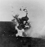 Ki-51 special attack aircraft of Japanese Army Sekicho Squadron striking USS Columbia in Lingayen Gulf, Philippine Islands, at 1729 hours on 6 Jan 1945; photograph taken from USS California