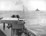 USS Columbia and other warships off Bougainville, Solomon Islands, 1-2 Nov 1943; note crashed Japanese aircraft ahead of USS Columbia