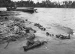 Dead Japanese soldiers and wrecked Daihatsu-class landing craft on Buna beach, New Guinea, 1943