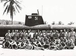 Officers and men of USS Dragonet posing before a Japanese submarine at Camp Dealy, Guam, Mariana Islands, mid- to late- Jun 1945