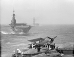 HMS Indomitable and HMS Eagle sailing behind HMS Victorious, 3-10 Aug 1942; note Hurricane and Albacore aircraft on Victorious