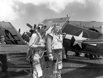 Two US Navy fighter pilots aboard carrier Enterprise during the raid on Truk Atoll in the Caroline Islands, 16 Feb 1944