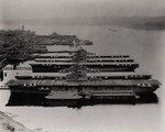 USS Essex, USS Ticonderoga, USS Yorktown, USS Lexington, USS Bunker Hill, and and USS Bon Homme Richard at Puget Sound Naval Shipyard, Washington, United States, 23 Apr 1948; note several battleships in background at left