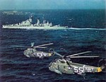 Two SH-3A Sea King helicopters flying past HNLMS De Zeven Provinciën and USS Essex in the Mediterranean Sea, 1967