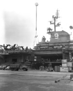 USS Essex docked at Yokosuka, Japan, 29 Sep 1951; note CCKW truck on pier and AFKWX truck on crane