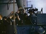 Personnel aboard HMS Formidable observing the invasion beach at Algiers, Algeria, 8 Nov 1942, photo 1 of 2