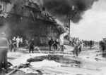 Firefighting aboard HMS Formidable after she was struck by a Japanese special attack aircraft in the Pacific Ocean off Sakishima Islands, Japan, 4 May 1945, photo 1 of 2