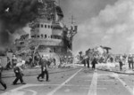 Firefighting aboard HMS Formidable after she was struck by a Japanese special attack aircraft in the Pacific Ocean off Sakishima Islands, Japan, 4 May 1945, photo 2 of 2