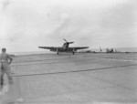 Fulmar aircraft of No. 803 Squadron FAA landing on HMS Formidable in the Indian Ocean off Madagascar, late Apr or early May 1942