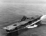 Franklin approaching New York City, New York, United States, 26 Apr 1945; note damage on her flight deck