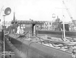 Port quarter view looking forward showing submarines Gar and Grampus fitting out, Groton, Connecticut, United States, 3 Jan 1941