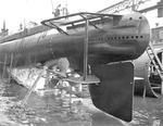 Submarine Gar in her cradle on launch day, showing her stern section, Groton, Connecticut, United States, 7 Nov 1940