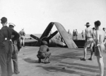 Corsair fighter in an elevator aboard HMS Glory, off Rabaul, New Britain, 6 Sep 1945, photo 2 of 2