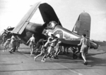 Preparing a Corsair aircraft for flight aboard HMS Glory, off Rabaul, New Britain, 6 Sep 1945