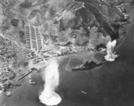 Carrier aircraft of US 3rd Fleet planes attacking battleship Haruna, Kure, Japan 28 Jul 1945; photo taken by aircraft from USS Intrepid
