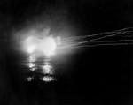 USS Helena performing night time bombardment of Japanese positions in the Munda-Vila area, New Georgia, Solomon Islands, 13 May 1943; photo taken from USS Honolulu